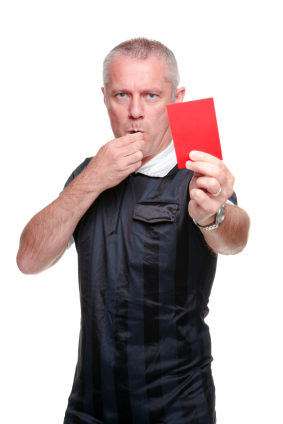 Football referee showing the red card