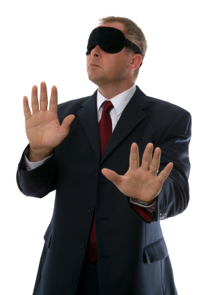Blindfolded businessman